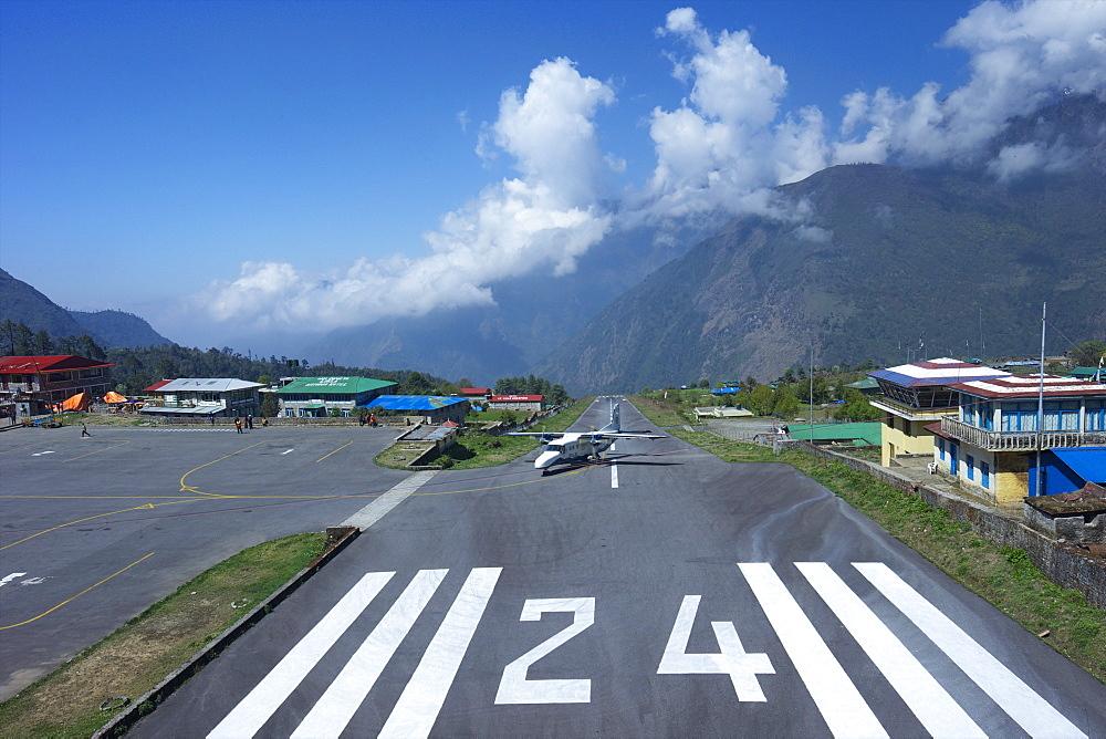 Sita Air Dornier 228 airplane landing on runway, Tenzing-Hillary Airport, Lukla, Nepal, Asia