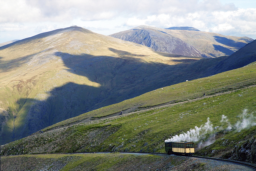 Steam engine and passenger carriage on trip down Snowdon Mountain Railway, Snowdonia National Park, Gwynedd, Wales, United Kingdom, Europe