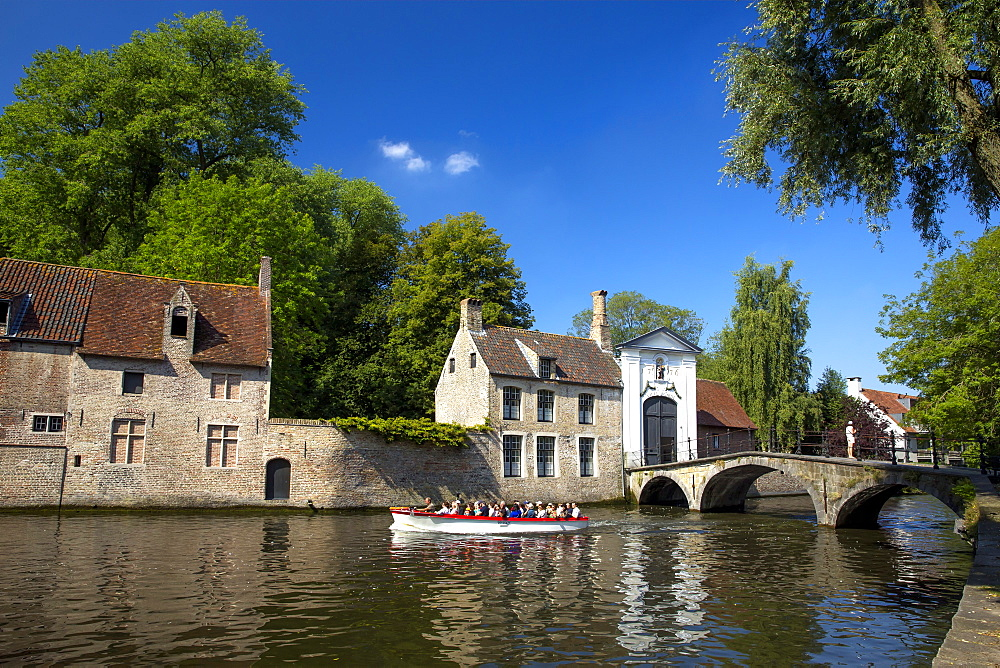 Tourist boat, at the Minnewater Lake and Begijnhof Bridge with entrance to Beguinage, Bruges, Belgium, Europe - 831-1527