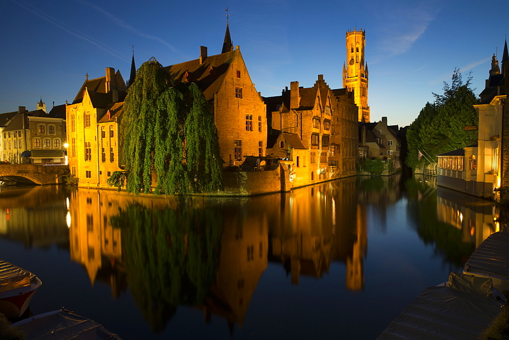 Evening reflections on Rozenhoedkaai, with Belfry (Belfort) Tower, UNESCO World Heritage Site, Bruges, West Flanders, Belgium, Europe
