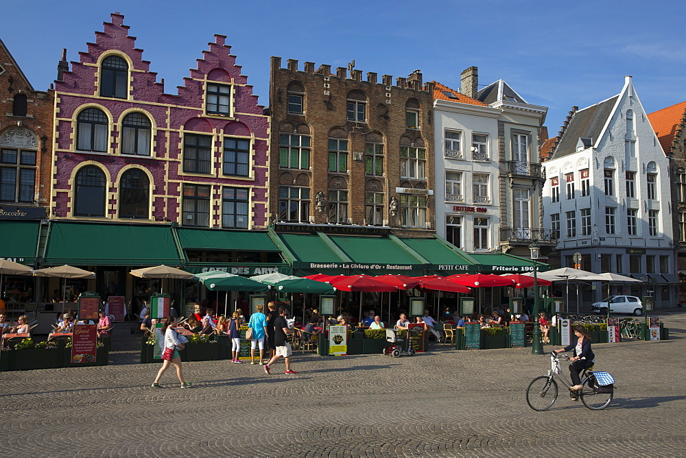 Tourists and visitors enjoying pavement cafes, Markt Square, Bruges, West Flanders, Belgium, Europe