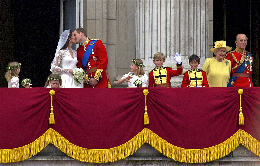 Prince William kisses his new wife Catherine Duchess of Cambridge during their public appearance on the balcony of Buckingham Palace, on their wedding day, London, England, United Kingdom, Europe