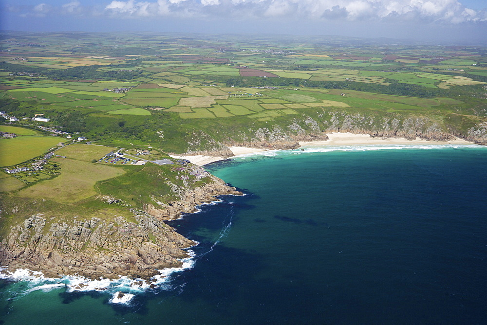 Aerial photo of Lands End Peninsula looking east to the Minnack Theatre and Porthcurno beach, West Penwith, Cornwall, England, United Kingdom, Europe