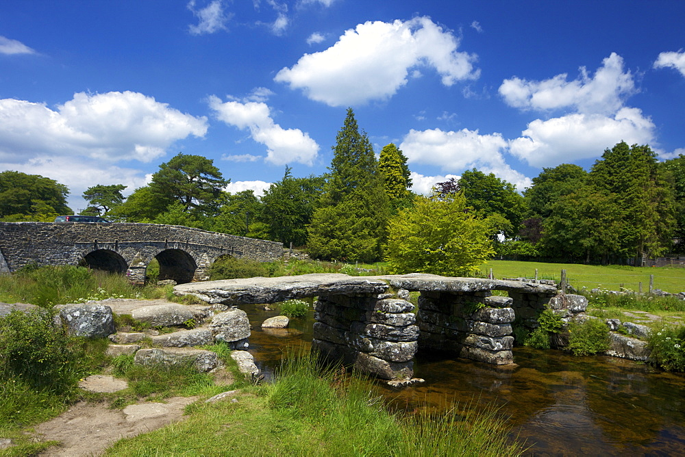 Medieval clapper bridge made of four massive granite slabs crossing the East Dart River, constructed in the 13th and 14th centuries, Postbridge, Dartmoor, Devon, England, United Kingdom, Europe