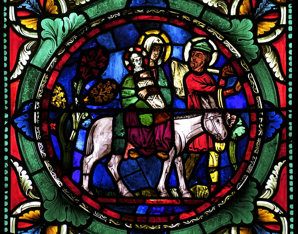 Medieval stained glass depicting Mary, baby Jesus and Joseph on a donkey, Canterbury Cathedral, UNESCO World Heritage Site, Canterbury, Kent, England, United Kingdom, Europe - 831-628