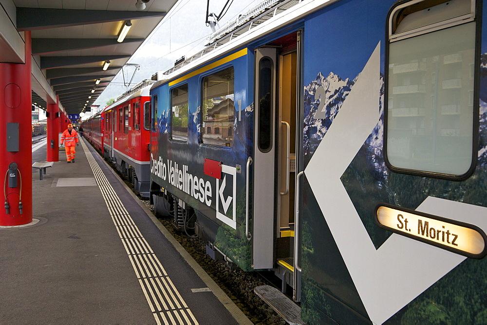 Bernina Express bound for St. Moritz, Switzerland, at Tirano station, Italy, Europe