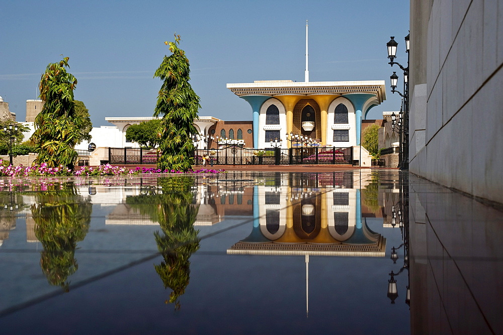 Main building of the Al Alam Palace, with reflection on the shiny polished tiles of the walkway, Muscat, Oman, Middle East