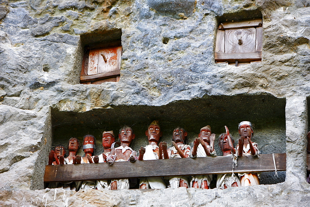 Rock tombs with figures, ancestral gallery, Lemo, Toraja culture, Sulawesi, Indonesia, Asia