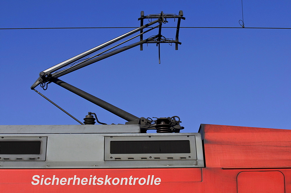 "Train, power car with pantograph, writing ""Sicherheitskontrolle"" security check, composing"