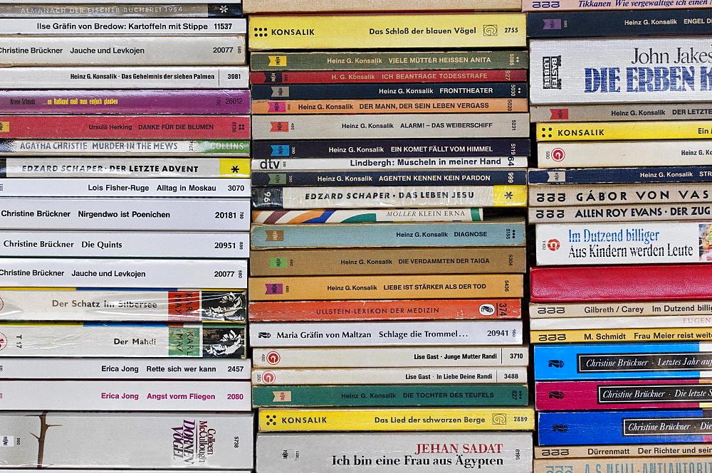 Antiquarian bookshop, stacked paperbacks, book spines