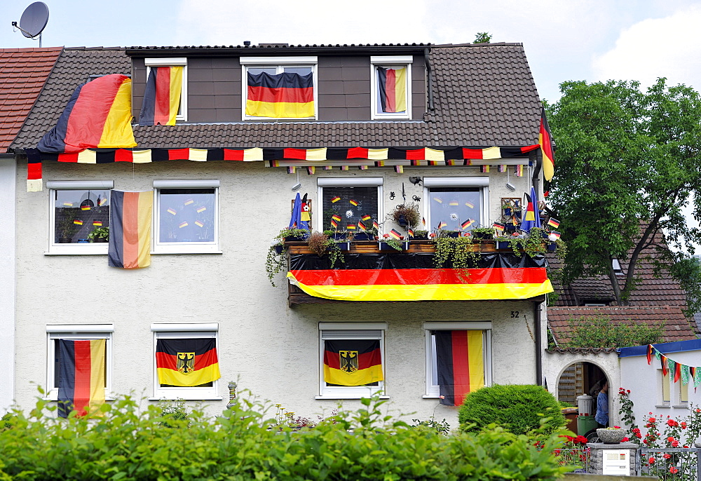 House decorated with German flags during Football World Cup 2010, Stuttgart, Baden-Wuerttemberg, Germany, Europe - 832-102743