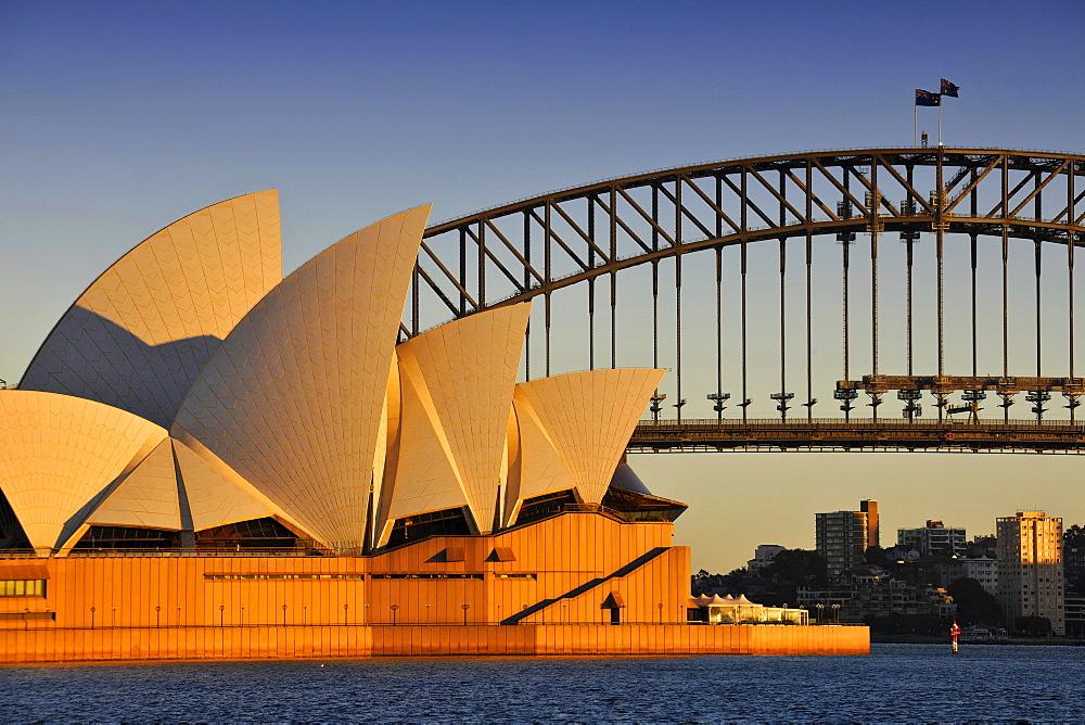 Sydney Opera House and Harbour Bridge at sunrise, Sydney, New South Wales, Australia