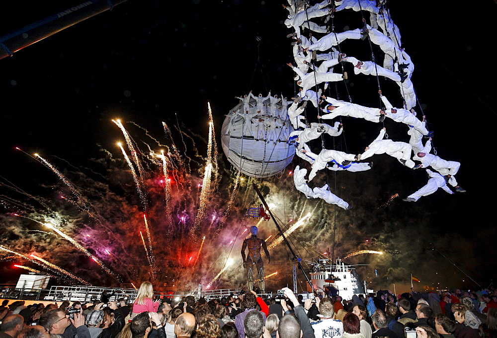 White-clad trapeze artists and globe floating in the sky, Global Rheingold, open-air theater by La Fura dels Baus, Duisburg-Ruhrort, Ruhrgebiet area, North Rhine-Westphalia, Germany, Europe