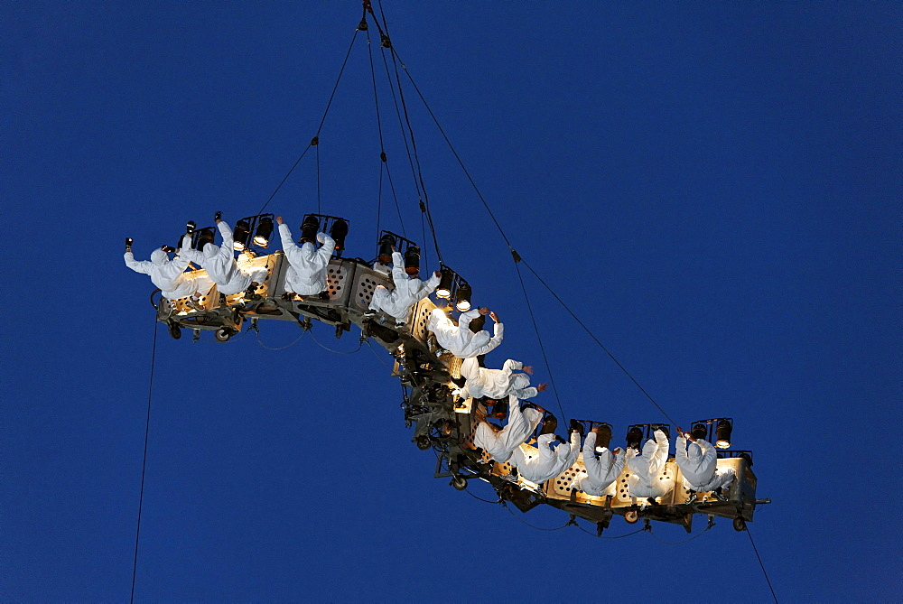 White-clad trapeze artists hanging upside down from a waved platform in the air, Global Rheingold, open-air theater by La Fura dels Baus, Duisburg-Ruhrort, Ruhrgebiet area, North Rhine-Westphalia, Germany, Europe