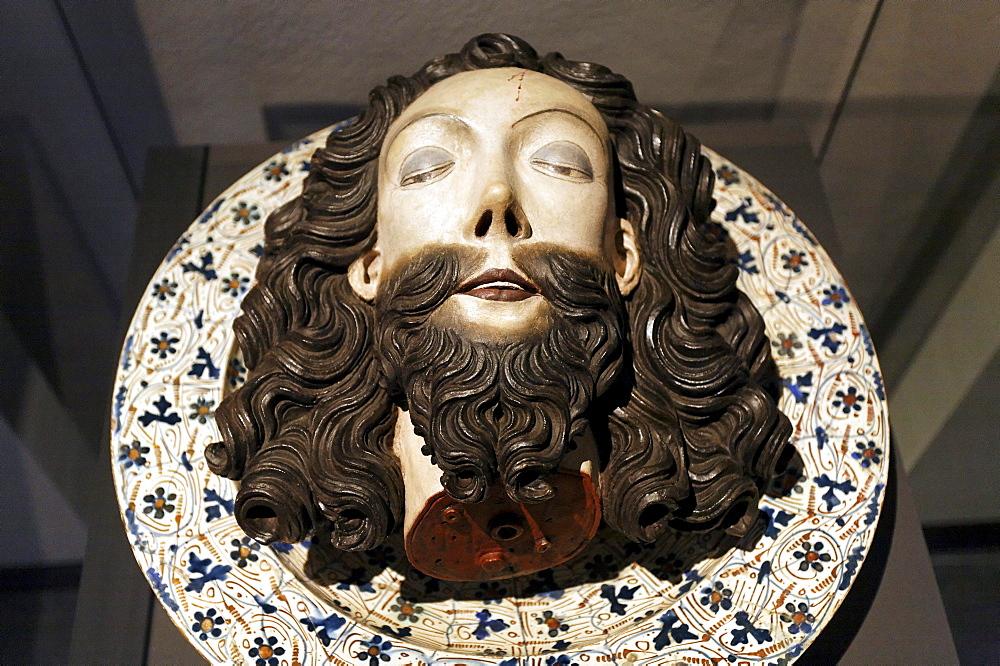 Severed head of John the Baptist lying on a plate, wood sculpture, Stiftsmuseum Museum Xanten monastery museum, Xanten, Niederrhein region, North Rhine-Westphalia, Germany, Europe