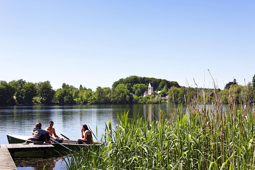 Wesslinger See lake, old parish church in Wessling, Fuenfseenland or Five Lakes region, Upper Bavaria, Bavaria, Germany, Europe