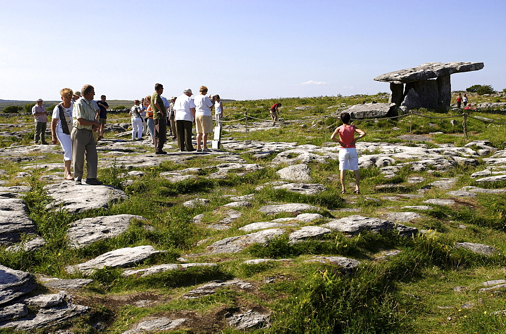 Tourists at the portal tomb, The Burren, Republic of Ireland, Europe