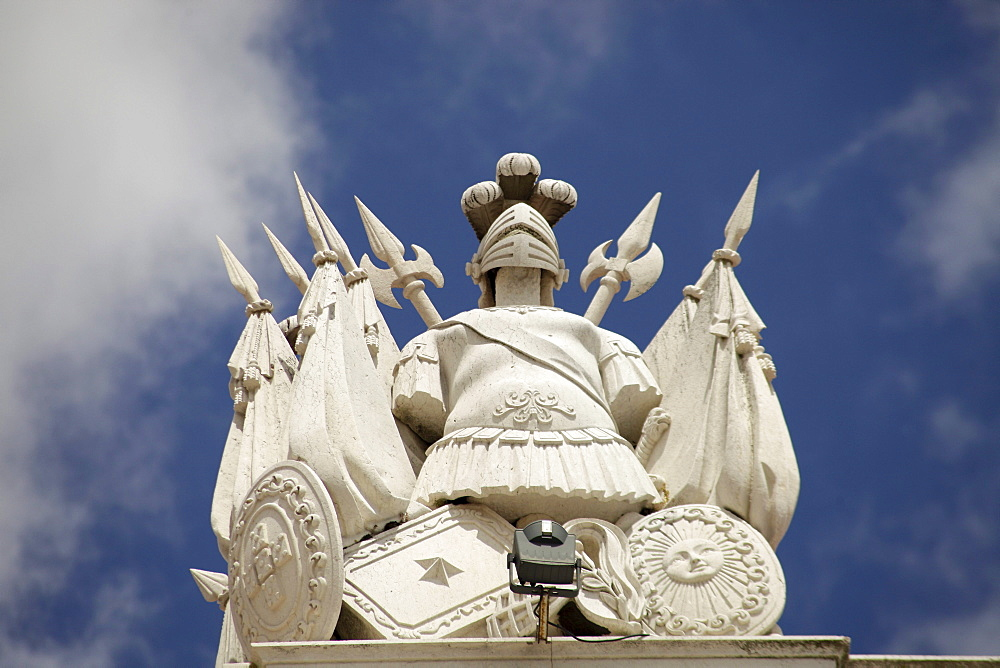 Armor, helmet and shield on a building on the Praca do Comercio square, Lisbon, Portugal, Europe