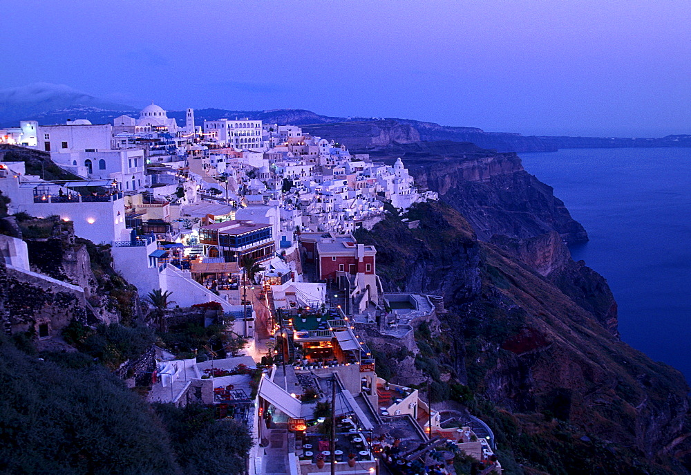 Town of Thira, Fira, on the crater rim, with typical Cycladic architecture, at dusk, Santorini, Cyclades, Greece, Europe