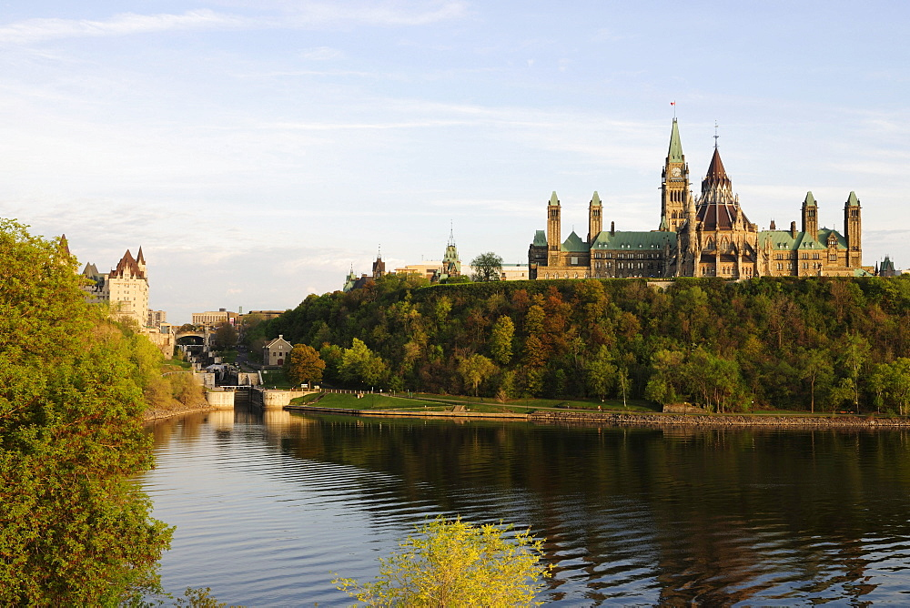 The government buildings on Parliament Hill, on the left the locks at the Rideau Canal, Ottawa, Ontario, Canada