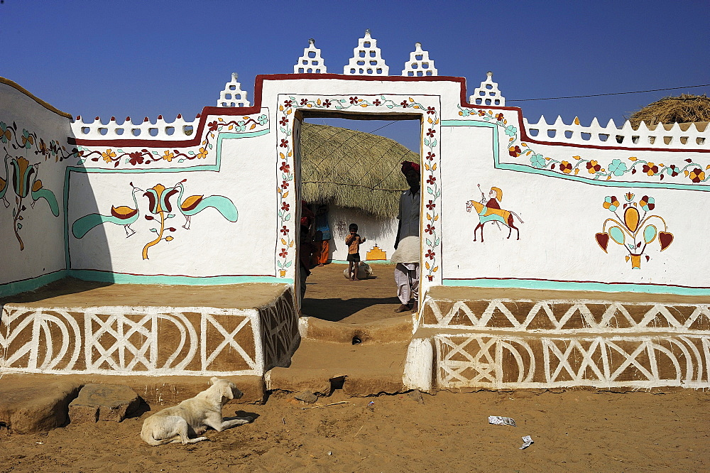 Traditionally painted wall and entrance to the courtyard of a house, Thar Desert, Rajasthan, North India, India, Asia