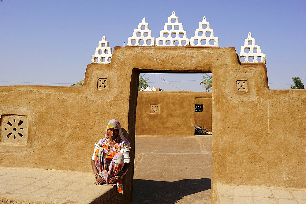 Young woman at the entrance to a courtyard, Thar Desert, Rajasthan, North India, India, Asia