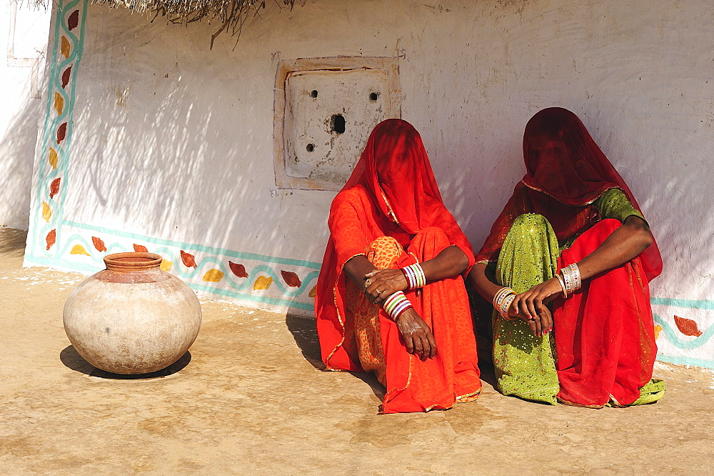 Veiled women talking in front of their house, Thar Desert, Rajasthan, North India, India, Asia
