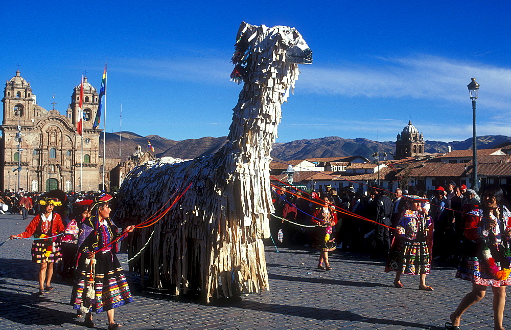 A huge Lama figure is carried over the Plaza de Armas square in Qusco, parade of the Inti Raymi festival, winter solstice festival, important festival of the Inca, Qusco, Peru, South America