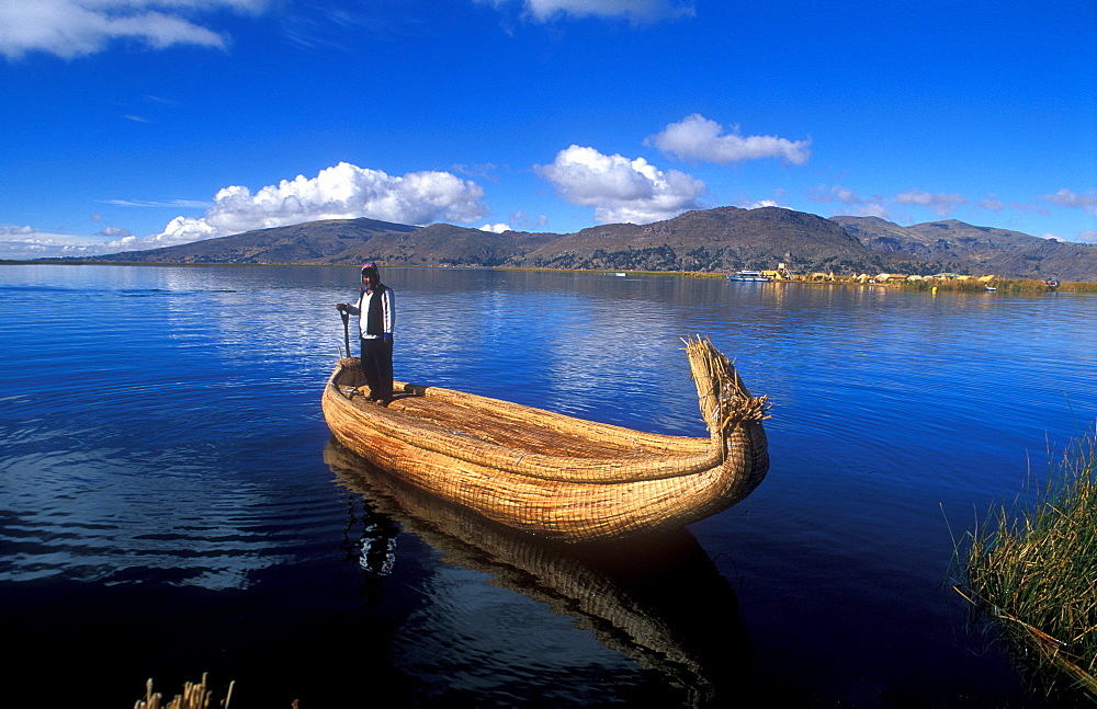 Aymara indigenous people on a reed boat made from Totora-reeds, Lake Titicaca, Peru, South America
