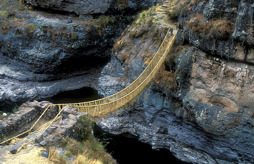 Queswachaka suspension bridge made from plant fibers, Ichu grass, over the Apurimac, Southern Peru, South America