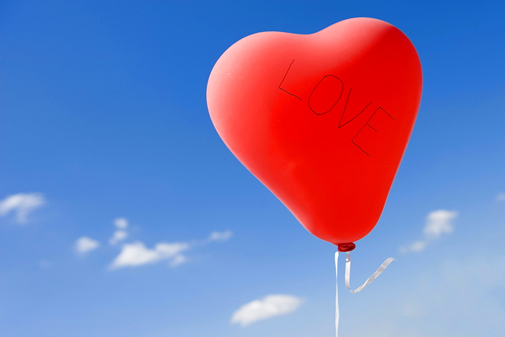 Red heart-shaped balloon, love