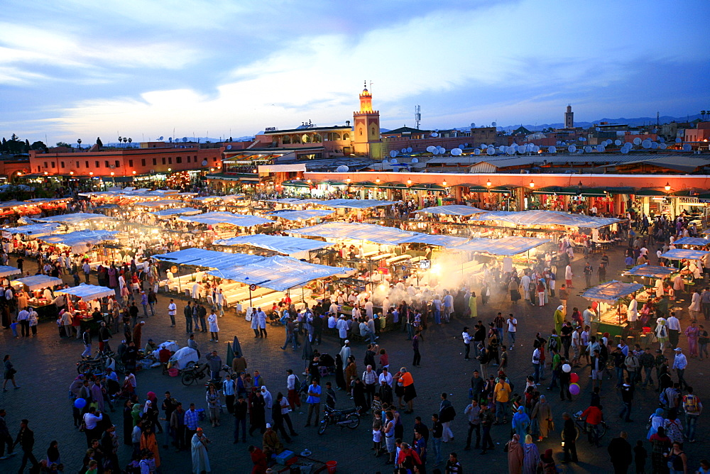 "Djemaa el-Fna, ""Square of the Hanged Man"" in the medina quarter of Marrakech at dusk with its countless food stalls, Marrekech, Morocco, Africa"