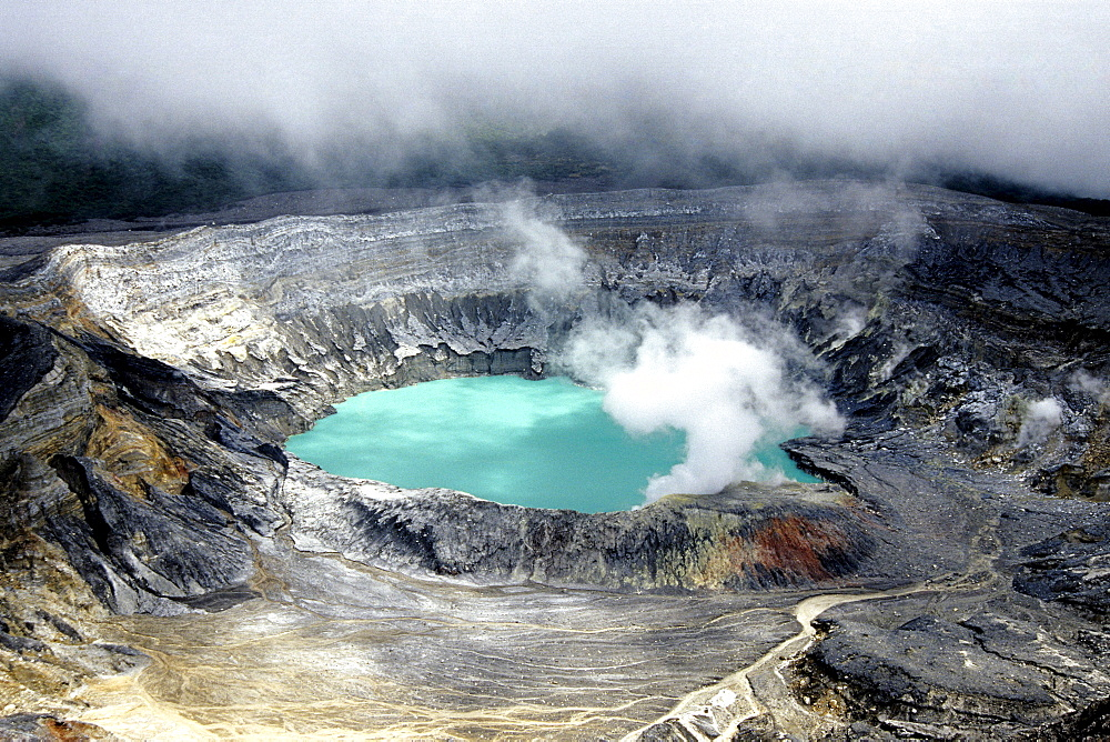 Poas Volcano, national park in the central highlands of the Alajuela Province, main crater with blue water, sulphur vapour, smoke and clouds, Parque Nacional Volcan Poas, Costa Rica, Central America