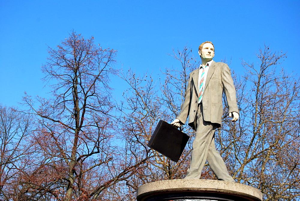 Businessman, sculpture on an advertising column, Duesseldorf, North Rhine-Westphalia, Germany, Europe