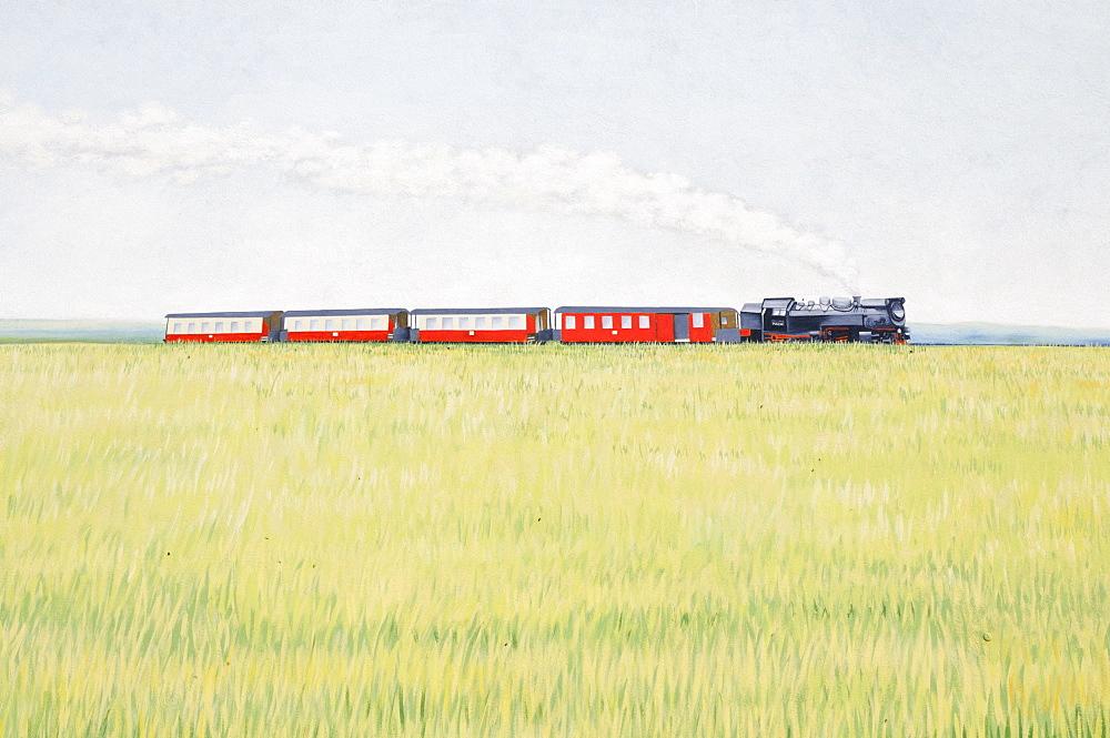 Mural on a house wall, steam locomotive motif