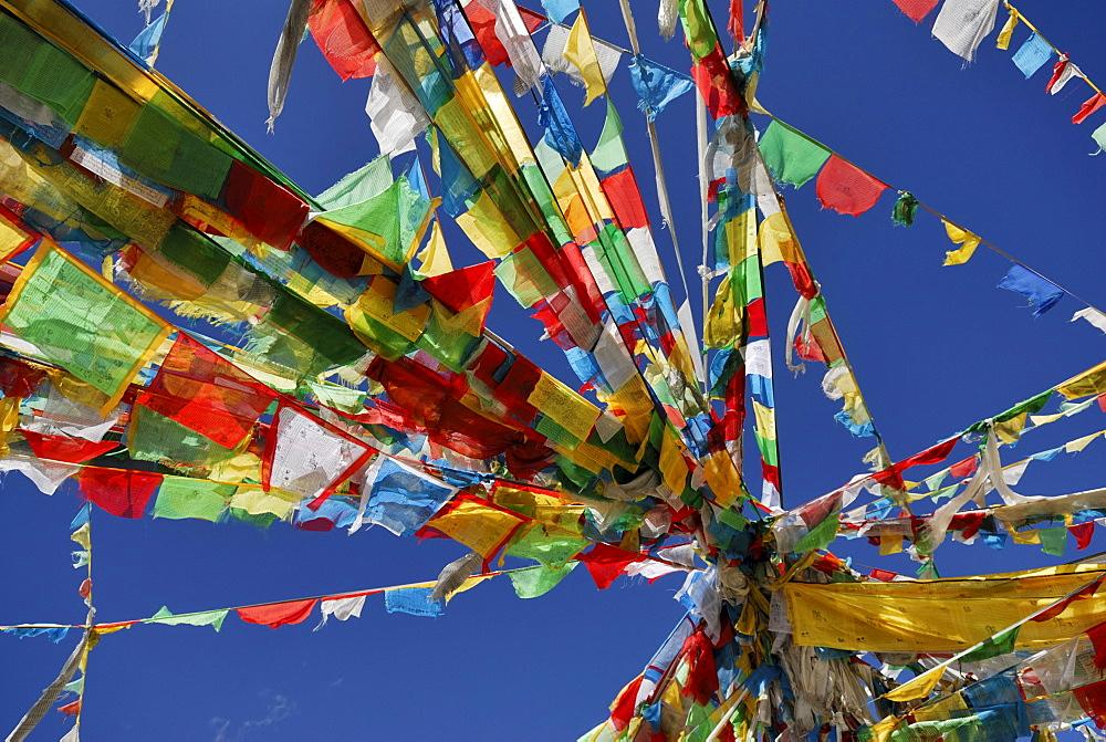 Prayer flags, Tra La Pass, Friendship Highway between Shigatse and Lhatse, Tibet, China, Asia