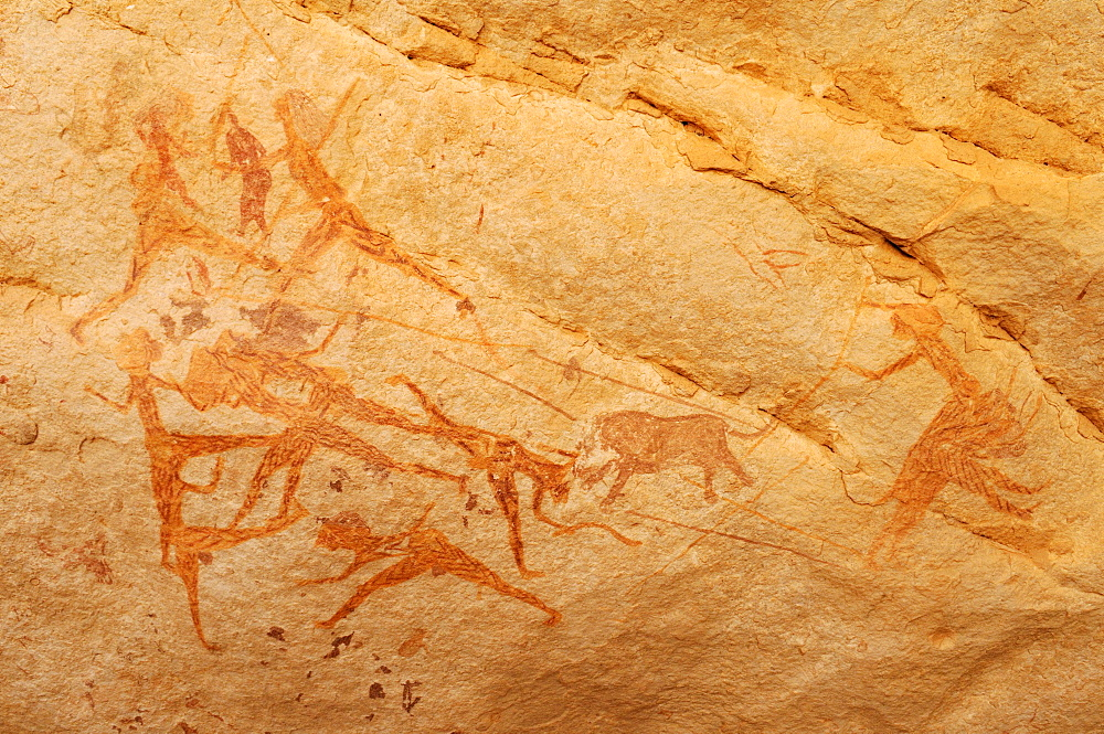 Lion hunt, neolithic rock art of the Tadrart, Tassili n'Ajjer National Park, Unesco World Heritage Site, Algeria, Sahara, North Africa