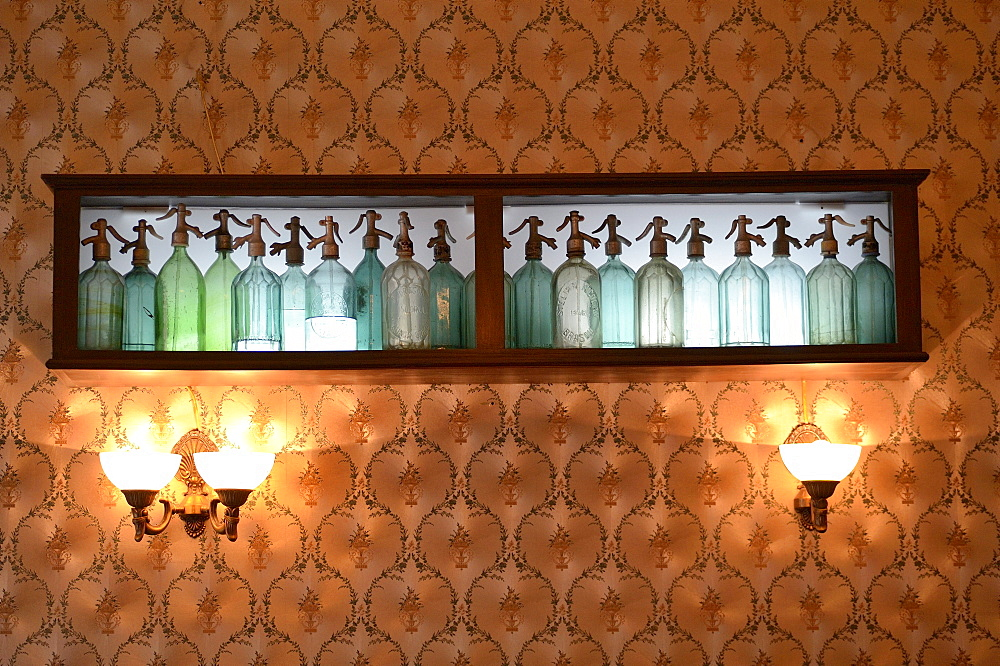 Soda syphon bottles used as a wall decoration in a cake store, Brasov, Romania, Europe - 832-109583