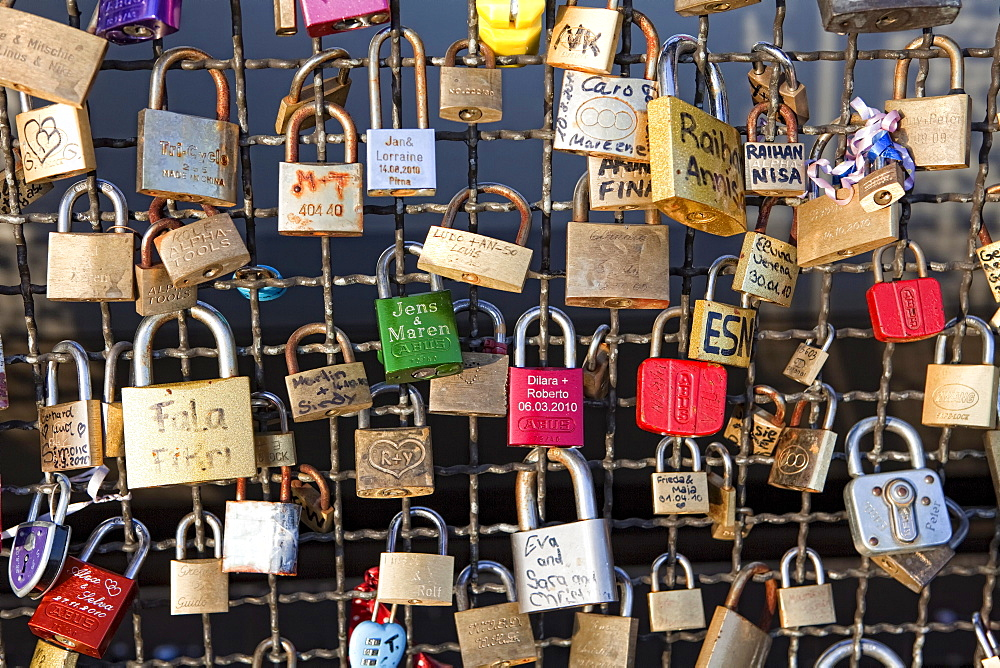Love padlocks on the railing of Hohenzollernbruecke bridge, Cologne, North Rhine-Westphalia, Germany, Europe