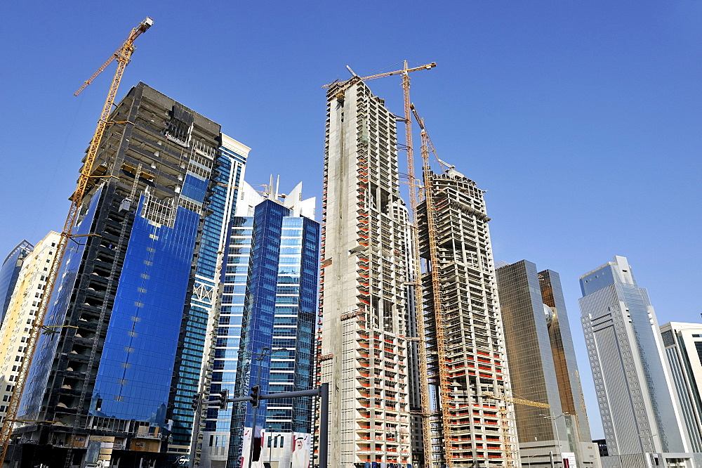 Construction of office buildings in the Financial District, Doha, Qatar, Arabian Peninsula, Persian Gulf, Middle East, Asia