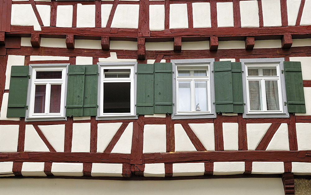 Half-timbered facade with windows, detail, Brackenheim, Zabergaeu, Baden-Wuerttemberg, Germany, Europe