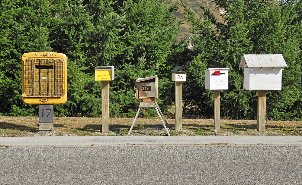 Individual letter boxes lining the access road to a new settlement, Arthurs Point, South Island, New Zealand