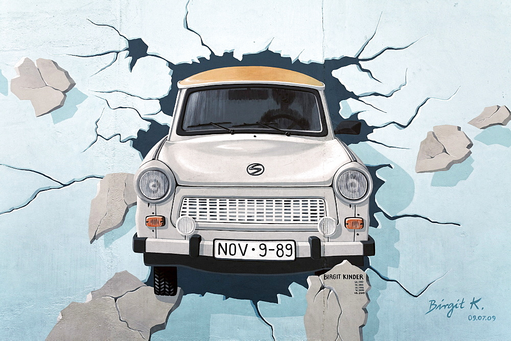 Trabant or Trabi breaking through the Berlin Wall, painting by Birgit Kinder, East Side Gallery, Friedrichshain district, Berlin, Germany, Europe