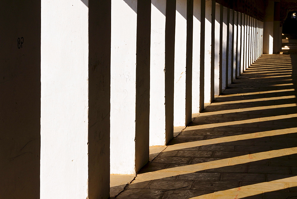 Colonnade and shadows in the Shwezigon Pagoda in Bagan, Myanmar, Burma, Southeast Asia, Asia