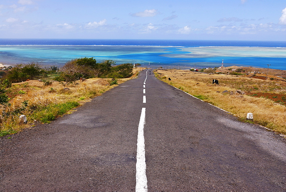 Road leading to the turquoise waters of the Indian Ocean, Rodrigues, Mauritius, Africa