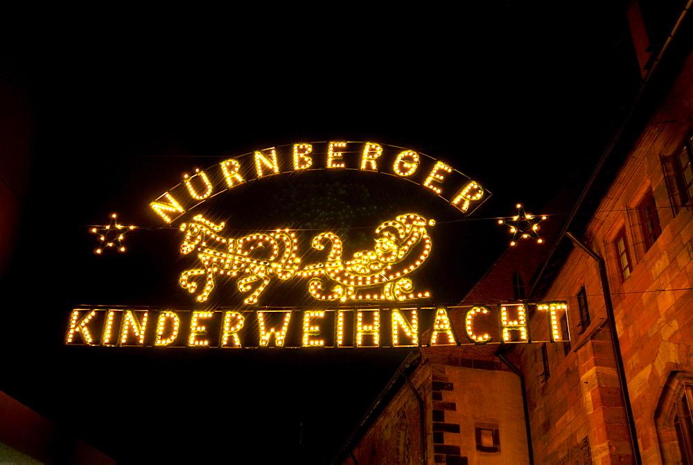 Illuminated entrance sign to the Nuernberger Kinderweihnacht children's Christmas market, Nuremberg, Bavaria, Germany, Europe