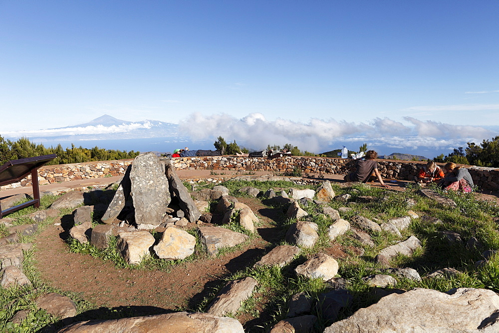 Reconstruction of a ceremonial site of the Guanches, aboriginal inhabitants of the Canary Islands, summit of Garajonay mountain, highest peak of La Gomera island, Tenerife island at the back, La Gomera island, Canary Islands, Spain, Europe