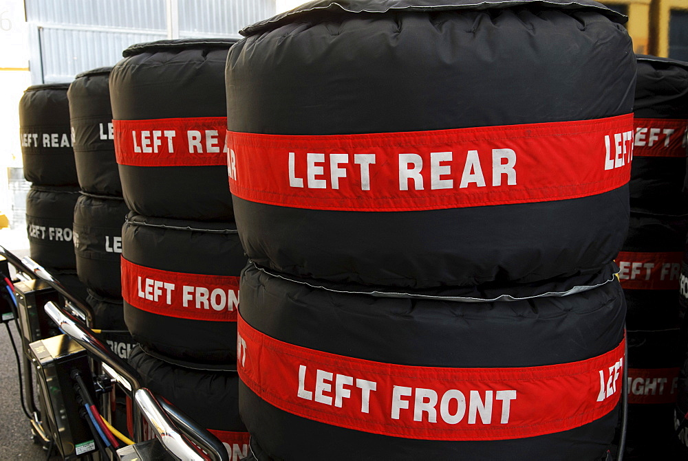 Stacks of Pirelli Formula 1 racing tyres packed in tyre warmers in the paddock at the Circuit Ricardo Tormo near Valencia, Spain, Europe