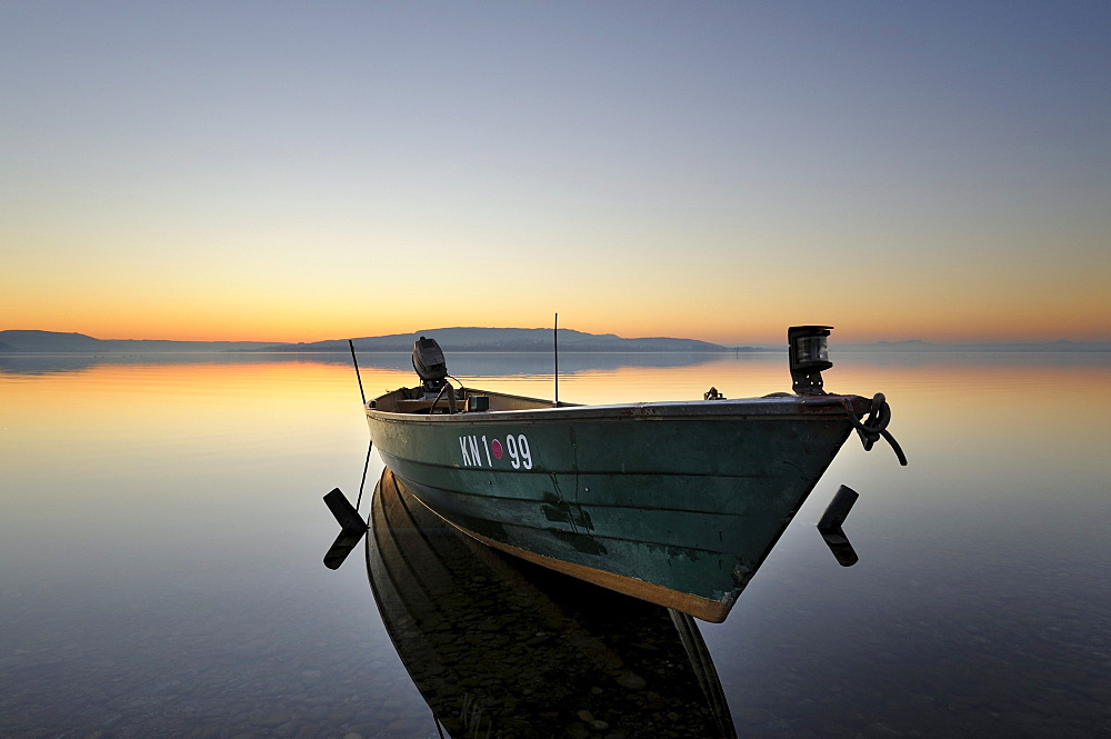 Evening mood with a fishing boat on the shore of the island of Reichenau, Konstanz district, Baden-Wuerttemberg, Germany, Europe