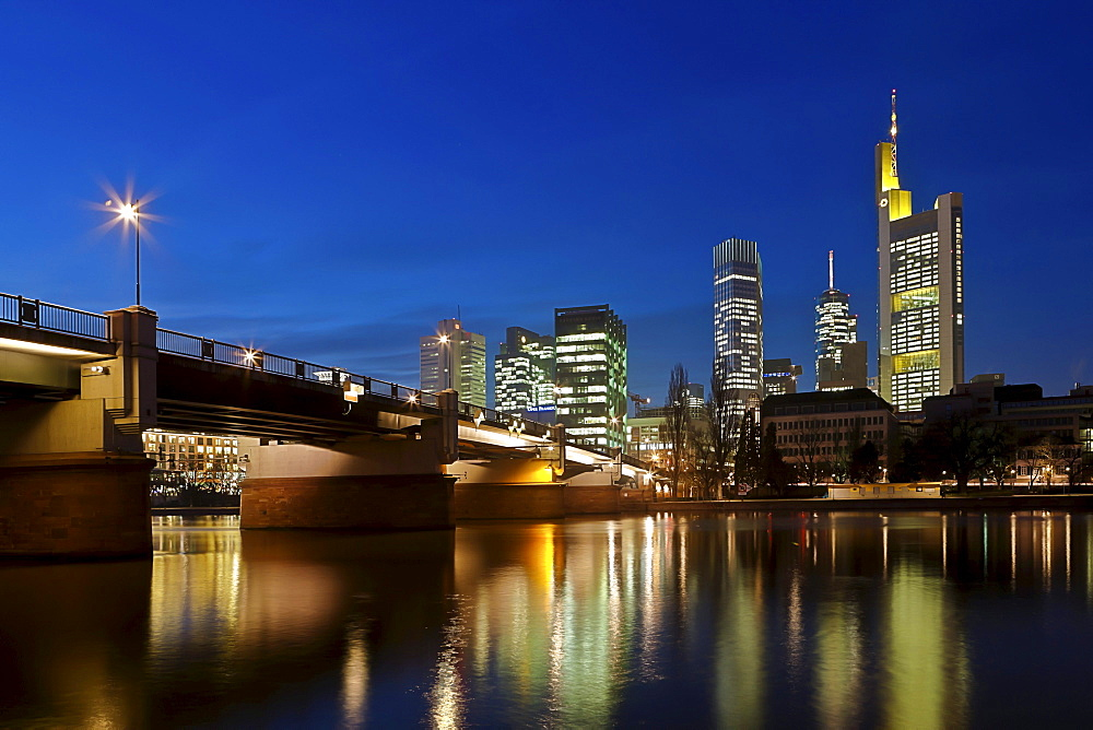 View towards Commerzbank Tower, European Central Bank, ECB, the Hessische Landesbank, Main Tower and Untermainbruecke Bridge at night, Frankfurt am Main, Hesse, Germany, Europe